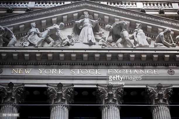 The New York Stock Exchange stands in New York US on Friday Aug 19 2016 US stocks slipped for the first time in three days with a recent rally...