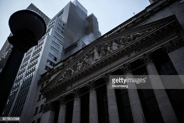 The New York Stock Exchange stands in New York US on Monday Dec 5 2016 US stocks climbed reversing a brief dip in early trading as Italian Prime...