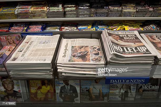The New York Times and other newspapers are displayed at a newsstand in the Times Square subway station July 18, 2006 in New York City. In a...