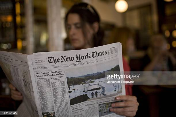 The New York Times being read at Pastis restaurant May, 2008 in New York City.
