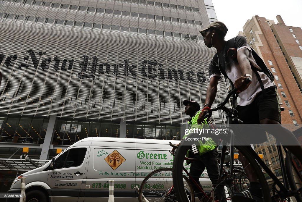 The New York Times building stands in Manhattan on July 27, 2017 in New York City. The New York Times Company shares have surged to a nine-year high after posting strong earnings on Thursday. Partly due to new digital subscriptions following the election of Donald Trump as president, the company reported a profit of $27.7 million in the second quarter, up from $9.1 million in the same period last year.