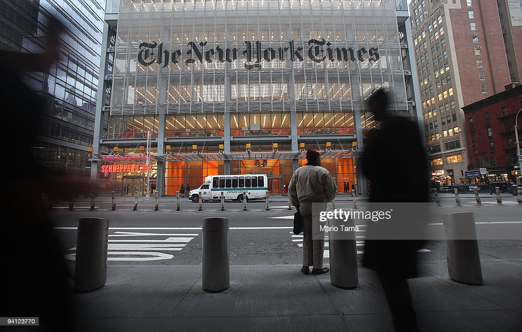 The New York Times' masthead is displayed in front of the midtown headquarters on December 7, 2009 in New York City. Today is the deadline for Times staffers to accept a buyout package in an effort to eliminate 100 newsroom employees this year in the struggling economy. The newspaper will likely fall short of the 100 buyouts and will need to layoff staffers to cut costs.