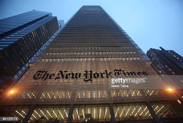 The New York Times' masthead is displayed in front of the midtown headquarters on December 7 2009 in New York City Today is the deadline for Times...