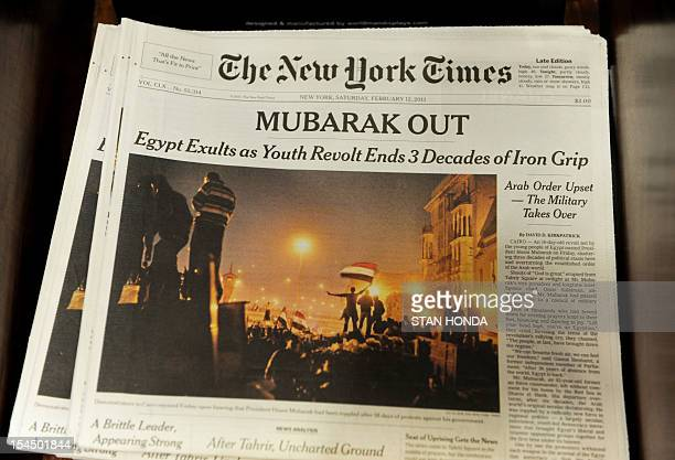 The New York Times on display February 12, 2011 in New York one day after a popular revolt that drove veteran strongman Hosni Mubarak from power in...