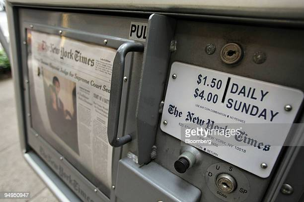 The New York Times sits on display in an honor box on Madison Avenue in New York US on Wednesday May 27 2009 The news stand price for the paper will...