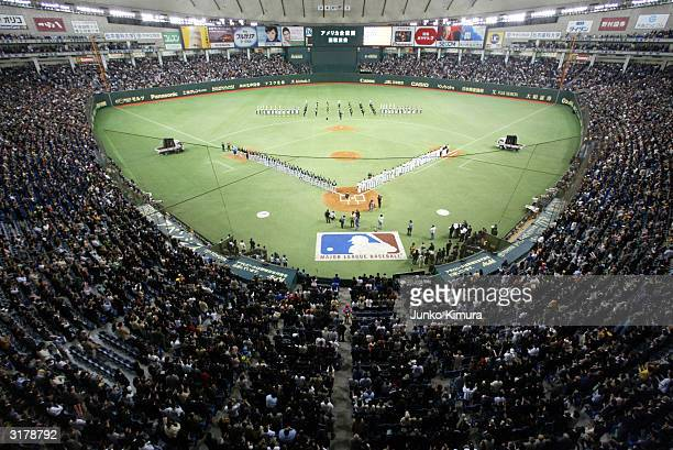 The New York Yankees and Tampa Bay Devil Rays line up along the baselines before the second game of the season at the Tokyo Dome March 31 2004 in...