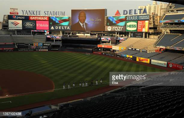 The New York Yankees and the New York Mets hold a moment of silence to honor the life of U.S. Rep. John Lewis before their Summer Camp game at Yankee...