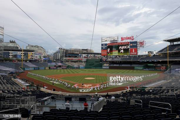 The New York Yankees and the Washington Nationals kneel during a moment of silence for Black Lives Matter prior to the game at Nationals Park on July...