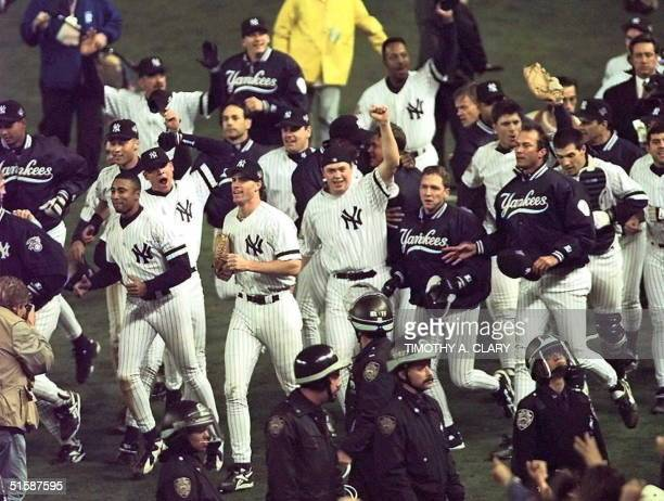 The New York Yankees celebrate 26 October after beating the Atlanta Braves in game six 32 to win the World Series at Yankee Stadium in New York AFP...