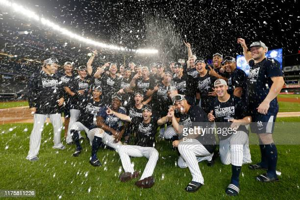 The New York Yankees celebrate after they clinched the American League East Division with a 91 win over the Los Angeles Angels at Yankee Stadium on...