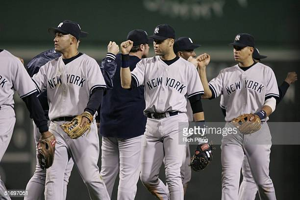 The New York Yankees celebrate after winning game three of the ALCS against the Boston Red Sox at Fenway Park on October 16 2004 in Boston...