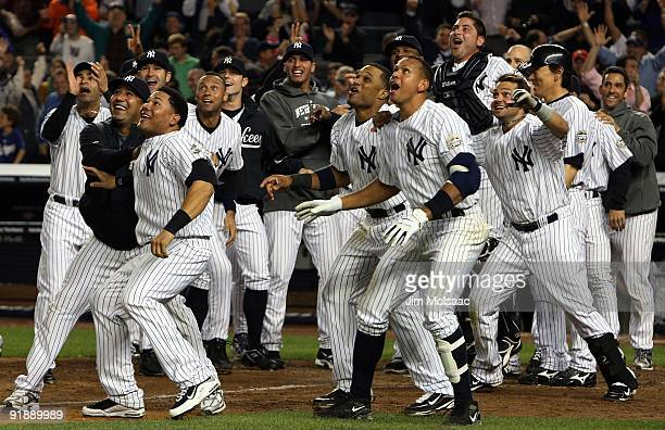 The New York Yankees celebrate Mark Teixeira's walk off home run in the eleventh inning against the Minnesota Twins in Game Two of the ALDS during...