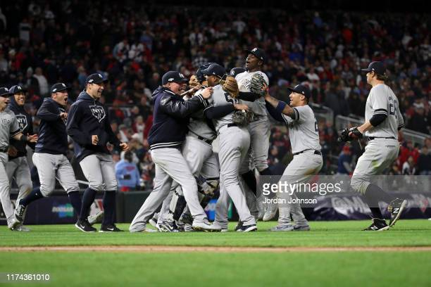 The New York Yankees celebrate the 5-1 win against the Minnesota Twins during Game 3 of the ALDS between the New York Yankees and the Minnesota Twins...
