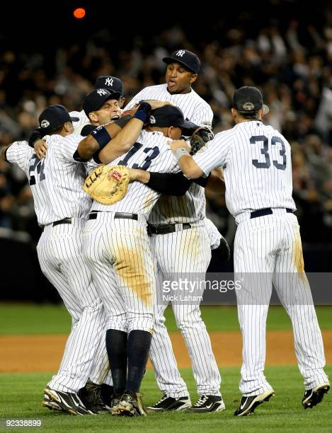 The New York Yankees celebrate their 52 victory over the Los Angeles Angels of Anaheim at the end of the top of the ninth inning in Game Six of the...