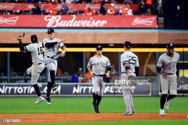 The New York Yankees celebrate their 7-0 win over the Houston Astros in game one of the American League Championship Series at Minute Maid Park on...