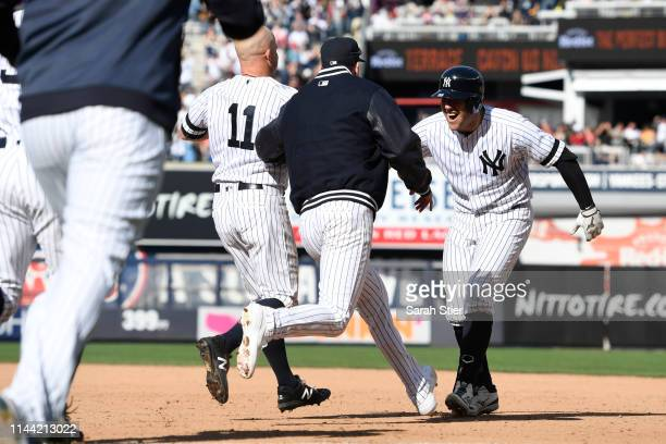The New York Yankees celebrate with teammate Austin Romine after their walkoff win during the tenth inning of the game against the Kansas City Royals...