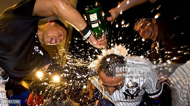 The New York Yankees defeat the Twins and celebrate Alex Rodriguez pours champagne on Derek Jeter