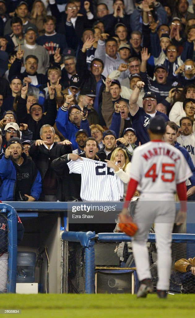 The New York Yankees fans taunt pitcher Pedro Martinez #45 of the Boston Red Sox after being taken out of the game in the eighth inning during game 7 of the American League Championship Series on October 16, 2003 at Yankee Stadium in the Bronx, New York.