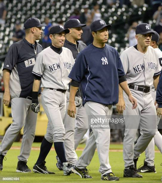 The New York Yankees' Ichiro Suzuki Hiroki Kuroda and manager Joe Girardi head back to the dugout after the final game of the regular season in...
