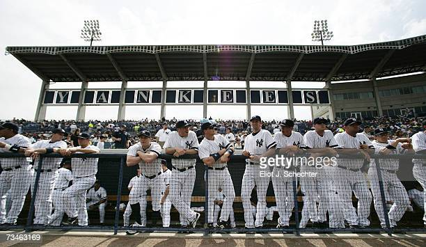 The New York Yankees line up in the dugout before the start of the game against the Minnesota Twins during Spring Training on March 1, 2007 at...