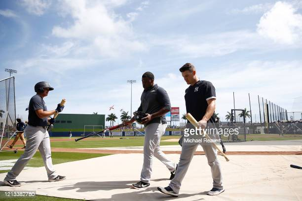 The New York Yankees look on during batting practice prior to the a Grapefruit League spring training game against the Washington Nationals at...