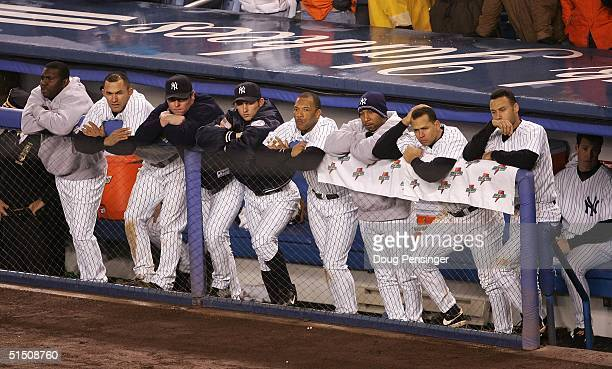 The New York Yankees look on from the dugout in the ninth inning against the Boston Red Sox during game six of the American League Championship...