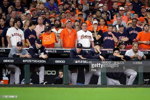 The New York Yankees looks on from the dugout against the Houston Astros during the ninth inning in game six of the American League Championship...