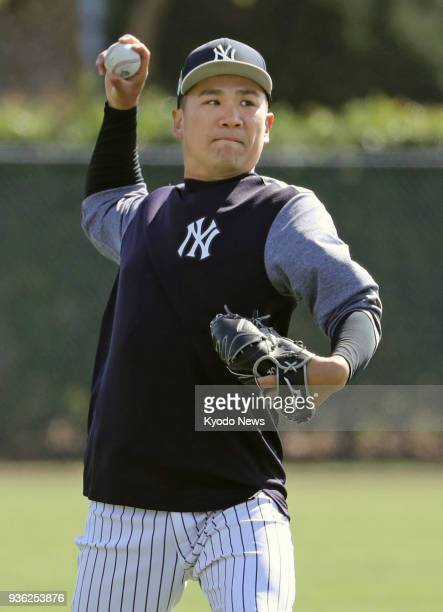 The New York Yankees' Masahiro Tanaka plays catch during practice in Tampa Florida on March 21 2018 ==Kyodo