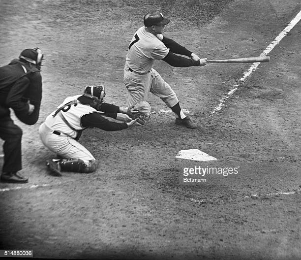 The New York Yankee's Mickey Mantle hits a homerun in the second game of the 1960 World Series against the Pirates