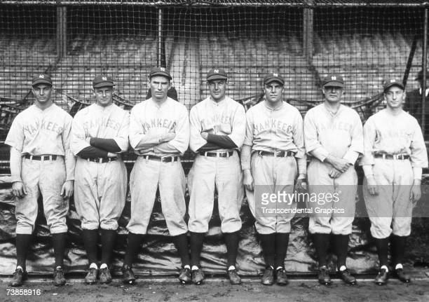 The New York Yankees pitching staff poses for a photo in Yankee stadium on October 4, 1928 before the start of game one of the World Series. They are...