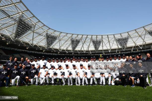 The New York Yankees players line up for a team photograph on the field during previews ahead of the MLB London Series games between Boston Red Sox...