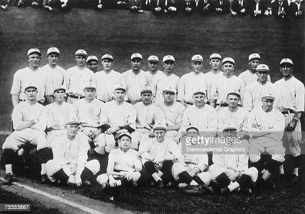 The New York Yankees pose for their team portrait in 1921. In the middle row Babe Ruth sits fourth from right and Waite Hoyt second from right, while...