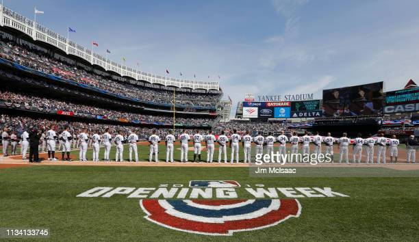 The New York Yankees stand for the national anthem on Opening Day against the Baltimore Orioles at Yankee Stadium on March 28, 2019 in the Bronx...