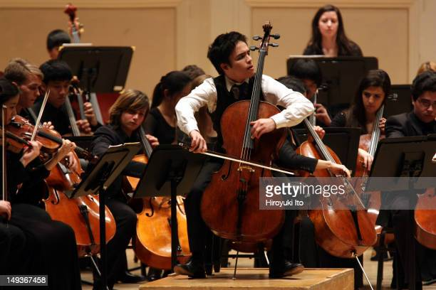 The New York Youth Symphony at Carnegie Hall on Sunday afternoon, March 11, 2012.Image shows Jay Campbell on cello with members of the New York Youth...