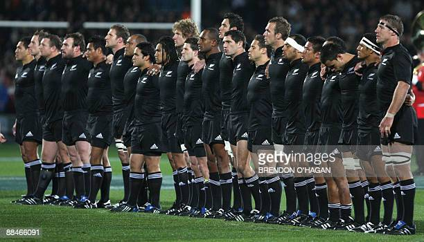 The New Zealand All Blacks line up for their national anthem before their rugby union Test match against France at Carisbrook Stadium in Dunedin on...
