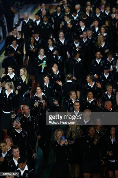 The New Zealand athletes wave as they arrive during the Opening Ceremony for the Glasgow 2014 Commonwealth Games at Celtic Park on July 23 2014 in...