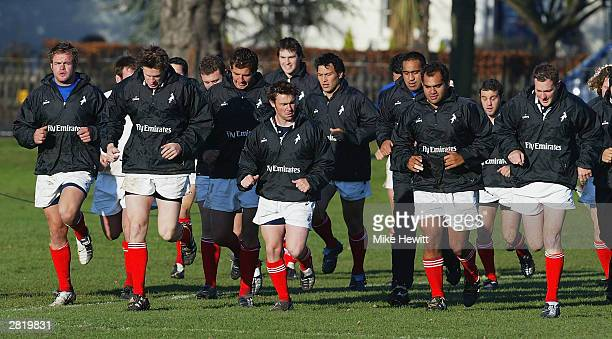 The New Zealand Barbarians warm-up during a training session at Dulwich College on December 18, 2003 in London.
