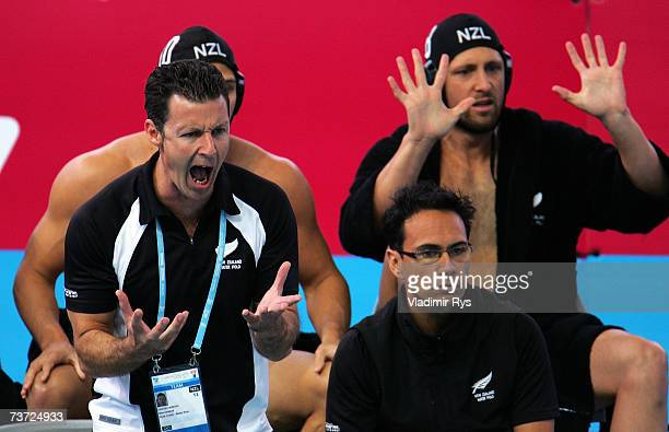 The New Zealand coach encourages his team during the Men's Final Round Water Polo match between Japan and New Zealand at the Melbourne Sports Aquatic...