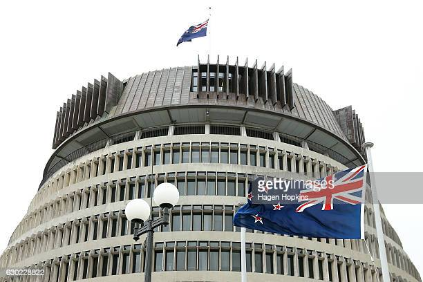 The New Zealand flag flies in front of The Beehive after a press conference at Parliament on December 18 2016 in Wellington New Zealand Bill English...