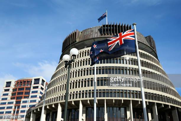 The New Zealand flag flies in front of The Beehive during Budget 2020 delivery day at Parliament May 14, 2020 in Wellington, New Zealand. Budget 2020...