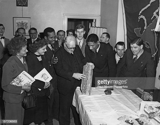 The New Zealand High Commissioner WJ Jordan receives a piece of stone from St Paul's Cathedral presented to him by a group of Danish Dutch and...