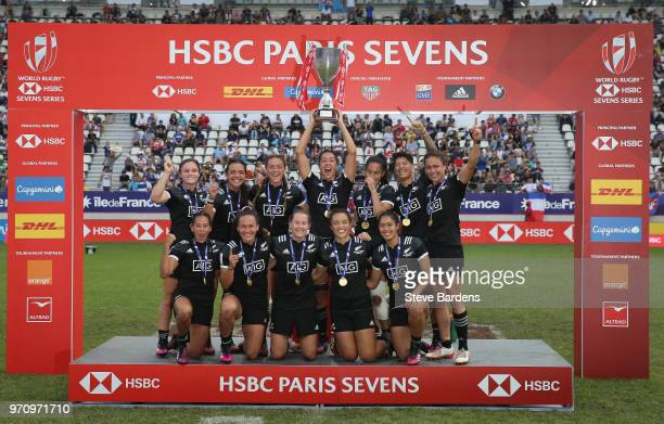 The New Zealand players celebrate with the Cup after their victory in the Women's Cup Final between New Zealand and Australia during the HSBC Paris...