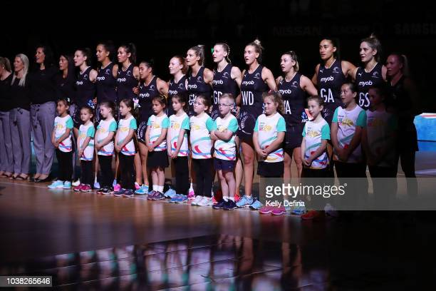 The New Zealand Silver Ferns are seen during the Australian national anthem prior to the Quad Series International Test match between the Australian...