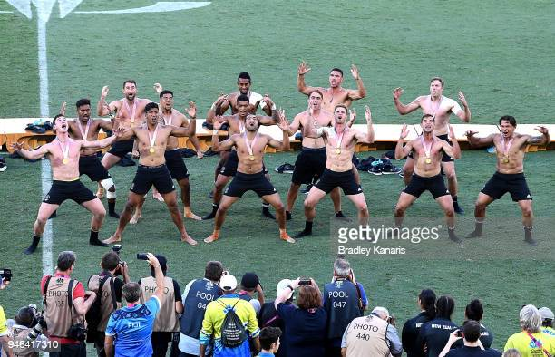 The New Zealand team celebrate victory as they perform a traditional dance after the MenÕs Gold Medal Final match between Fiji and New Zealand during...