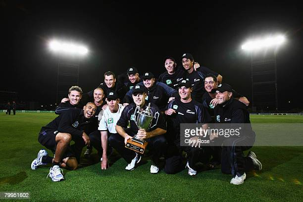 The New Zealand team celebrate with the series trophy after they win the fifth National Bank series One Day International match between New Zealand...