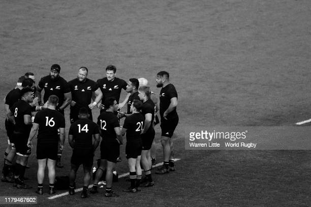 The New Zealand team huddle after scoring a try during the Rugby World Cup 2019 Group B game between New Zealand and Namibia at Tokyo Stadium on...