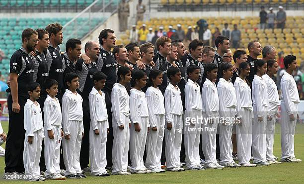 The New Zealand team observe a minute's silence in memory of the victims of the Christchurch Earthquake ahead of the 2011 ICC World Cup Group A match...