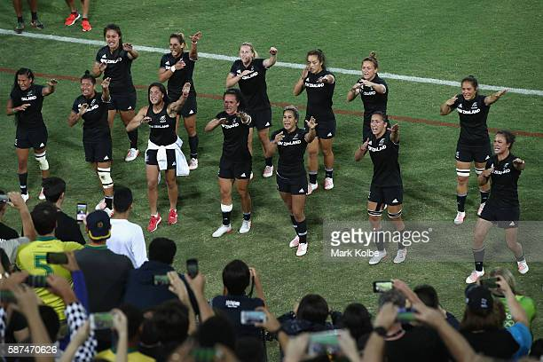 The New Zealand team perform a dance to their supporters after defeat during the Women's Gold Medal Final Rugby Sevens match between Australia and...