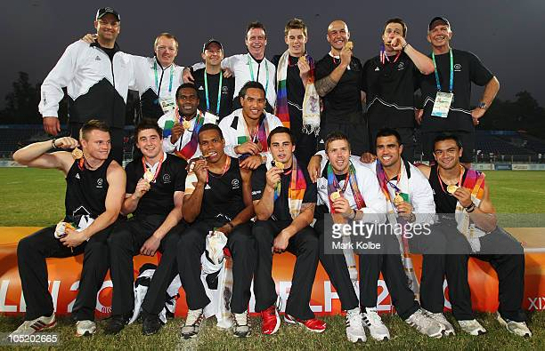 The New Zealand team pose with their gold medals as they celebrate winning the rugby 7's Gold Medal match between New Zealand and Australia at Delhi...