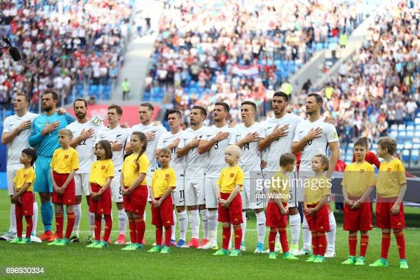 The New Zealand team sing the national anthem prior to the FIFA Confederations Cup Russia 2017 Group A match between Russia and New Zealand at Saint...